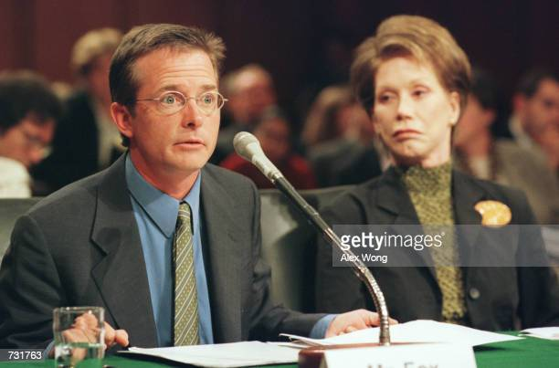 Actor Michael J Fox left testifies as actress Mary Tyler Moore looks on before the US Senate subcommittee on Labor Health and Human Services...