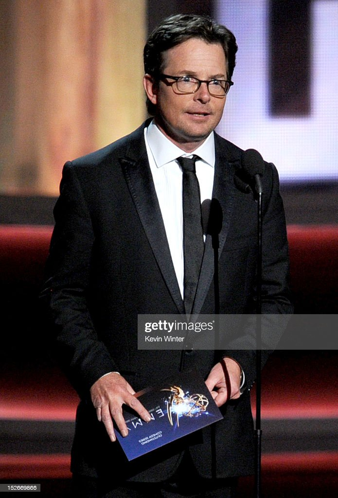 Actor <a gi-track='captionPersonalityLinkClicked' href=/galleries/search?phrase=Michael+J.+Fox&family=editorial&specificpeople=208846 ng-click='$event.stopPropagation()'>Michael J. Fox</a> speaks onstage during the 64th Annual Primetime Emmy Awards at Nokia Theatre L.A. Live on September 23, 2012 in Los Angeles, California.