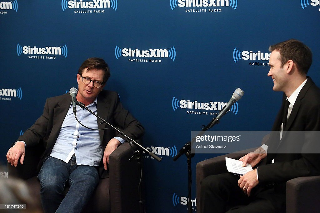 Actor Michael J. Fox talks EW Radio host Dalton Ross at SiriusXM's 'Town Hall' series at SiriusXM Studios on September 24, 2013 in New York City.