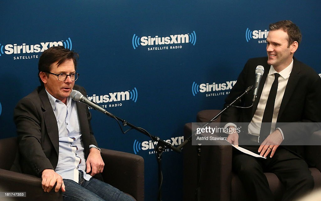 Actor Michael J. Fox talks with EW Radio host Dalton Ross (R) at SiriusXM's 'Town Hall' series at SiriusXM Studios on September 24, 2013 in New York City.