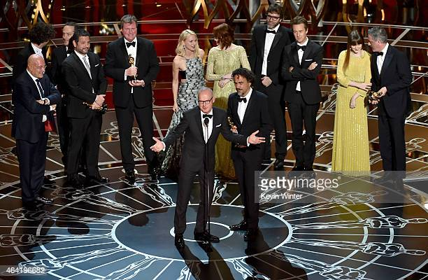 Actor Michael Keaton and director Alejandro Gonzalez Inarritu with cast and crew accept the Best Picture award for 'Birdman' onstage during the 87th...