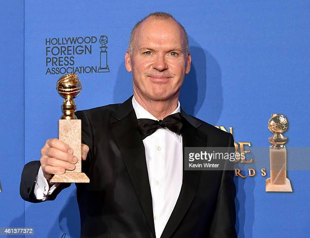 Actor Michael Keaton winner of Best Actor in a Motion Picture Musical or Comedy for 'Birdman' poses in the press room during the 72nd Annual Golden...