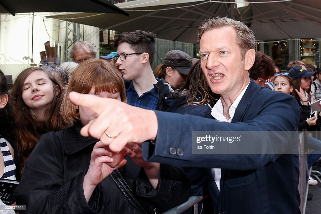 Actor Michael Kessler with fans during the Berlin premiere of the film 'Angry Birds - Der Film' at CineStar on May 1, 2016 in Berlin, Germany.