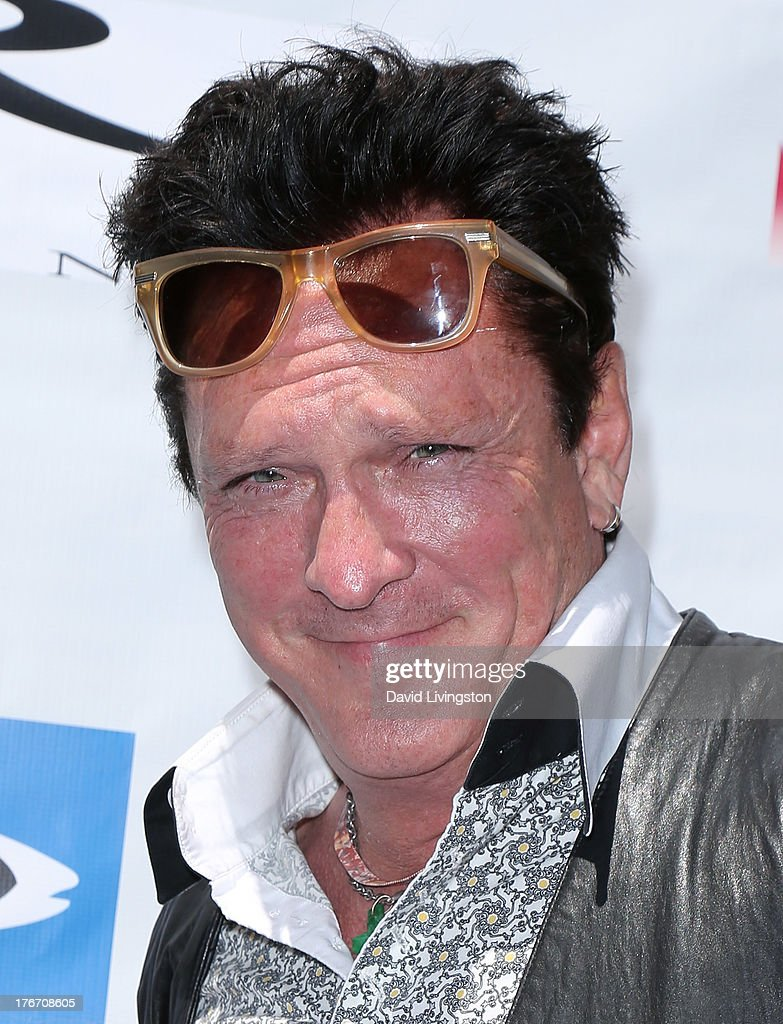 Actor <a gi-track='captionPersonalityLinkClicked' href=/galleries/search?phrase=Michael+Madsen&family=editorial&specificpeople=171692 ng-click='$event.stopPropagation()'>Michael Madsen</a> attends the 'Free Willy' 20th Anniversary Celebration at the Egyptian Theatre on August 17, 2013 in Hollywood, California.