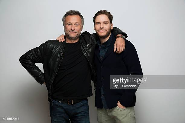 Actor Michael Nyqvist and actor Daniel Bruhl from the film 'Colonia' are photographed for Los Angeles Times on September 25 2015 in Toronto Ontario...