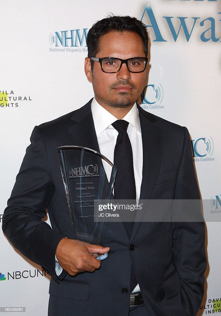 Actor Michael Pena poses with his Outstanding Performance in a Motion Picture Award during the National Hispanic Media Coalition's 16th Annual Impact Awards Gala at the Beverly Wilshire Four Seasons Hotel on February 22, 2013 in Beverly Hills, California.