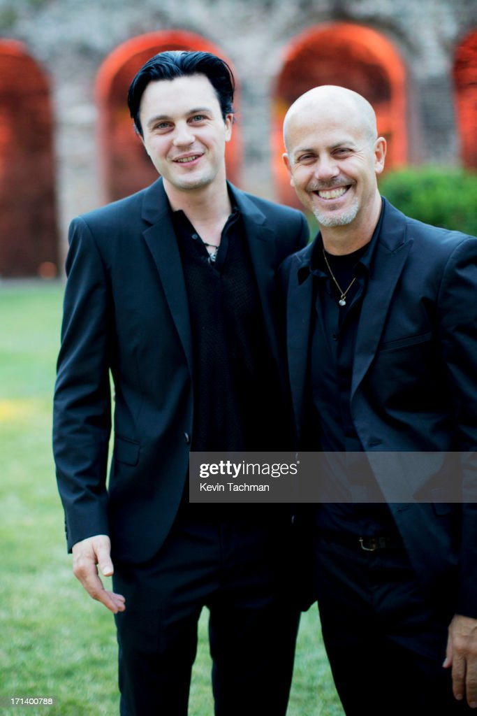 Actor Michael Pitt, left, and designer Italo Zucchelli attend the dinner to celebrate Italo Zucchelli's ten years as Calvin Klein Collection's mens creative director on June 23, 2013 in Milan, Italy.