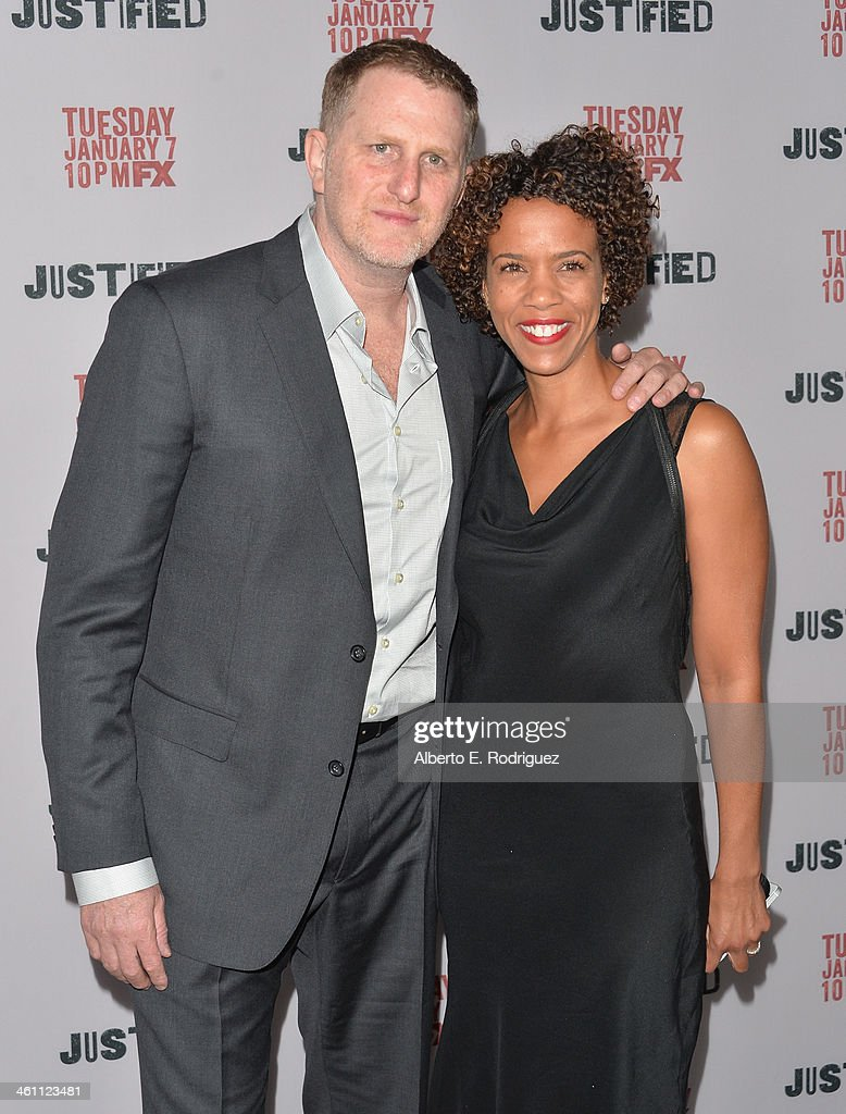 Actor Michael Rapaport and Bebe Dunne arrive to the Season 5 premiere of FX's 'Justified' at DGA Theater on January 6, 2014 in Los Angeles, California.