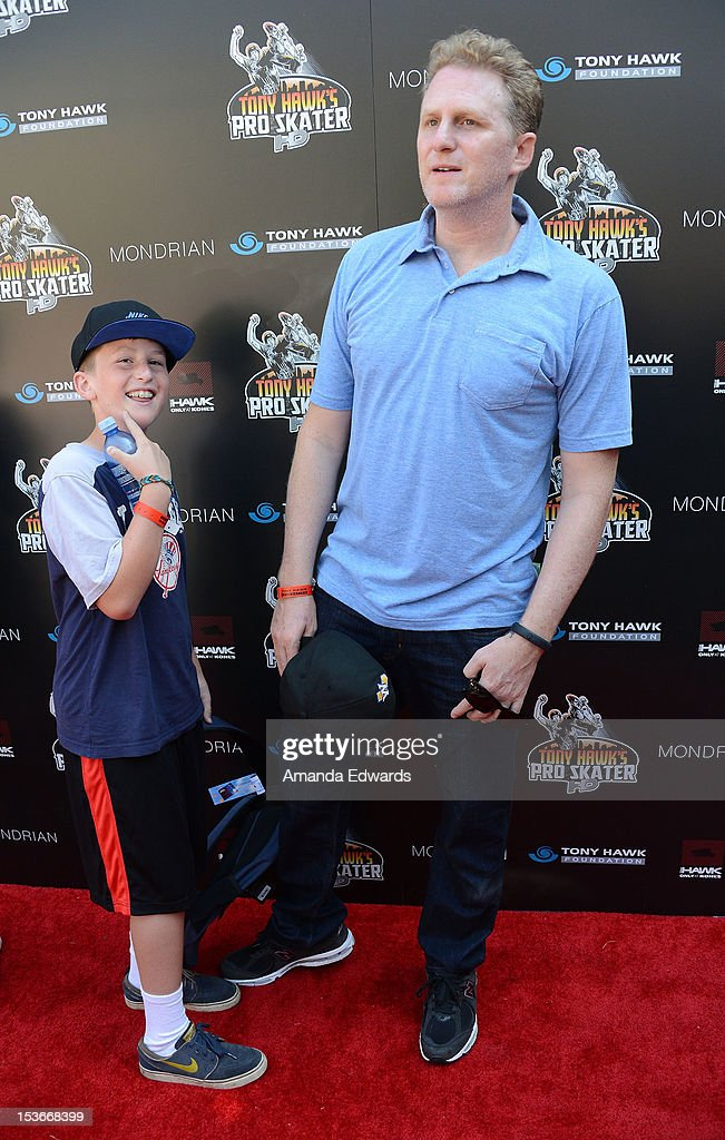 Actor Michael Rapaport (R) and his son Maceo arrive at the 9th Annual Stand Up For Skateparks Benefiting The Tony Hawk Foundation at a private residence on October 7, 2012 in Beverly Hills, California.