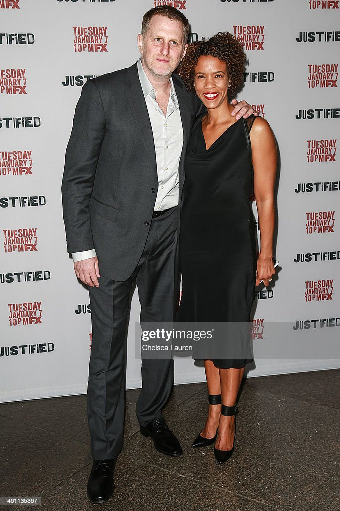 Actor Michael Rapaport (L) and Kebe Dunn attend the Los Angeles premiere of FX's 'Justified' at DGA Theater on January 6, 2014 in Los Angeles, California.