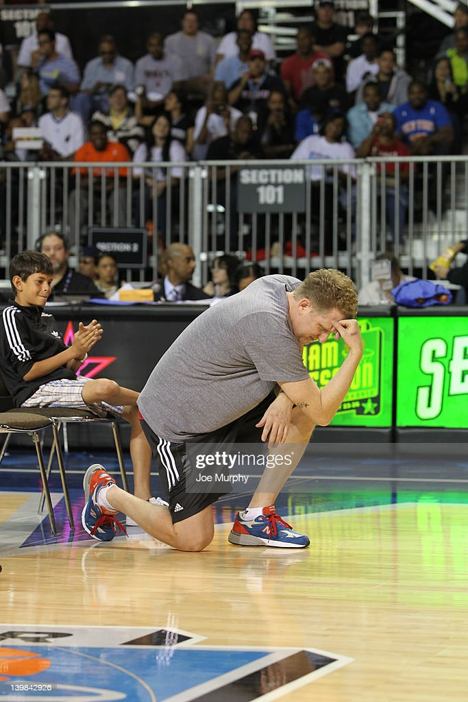Actor Michael Rapaport prepares to shoot the ball during the Celebrity 3-Point Contest on center court at Jam Session during the NBA All-Star Weekend on February 25, 2012 at the Orange County Convention Center in Orlando, Florida.