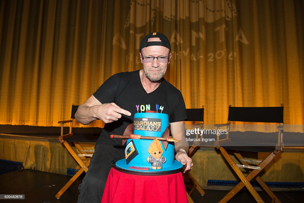 Actor <a gi-track='captionPersonalityLinkClicked' href=/galleries/search?phrase=Michael+Rooker&family=editorial&specificpeople=640228 ng-click='$event.stopPropagation()'>Michael Rooker</a> surprise birthday cake during the Marvel's Guardians of the Galaxy Q&A session at The Plaza Theatre on April 10, 2016 in Atlanta, Georgia.
