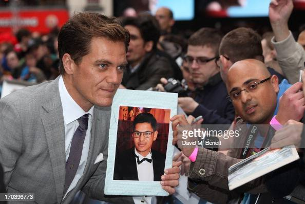 Actor Michael Shannon signs autographs as he attends the UK Premiere of 'Man of Steel' at Odeon Leicester Square on June 12 2013 in London England