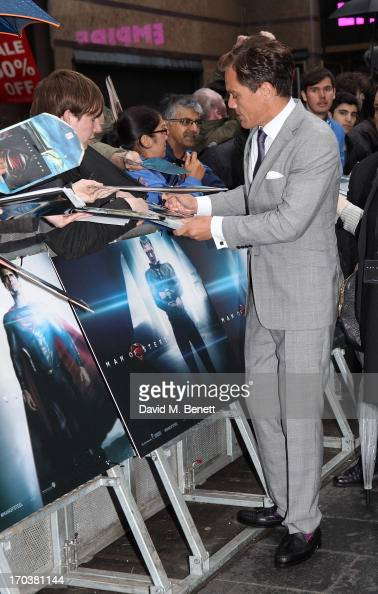 Actor Michael Shannon signs autographs for fans as he attends the UK Premiere of 'Man of Steel' at Odeon Leicester Square on June 12 2013 in London...