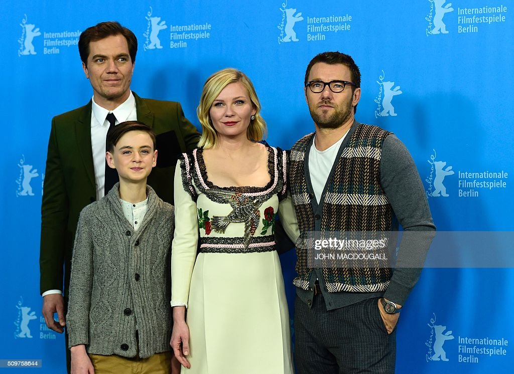 US actor Michael Shannon, US Jaeden Lieberher, US actress Kirsten Dunst, Australian actor Joel Edgerton attend a photo call for the film ' Midnight Special by Jeff Nichols' screened in competition of the 66th Berlinale Film Festival in Berlin on February 12, 2016. / AFP / John MACDOUGALL