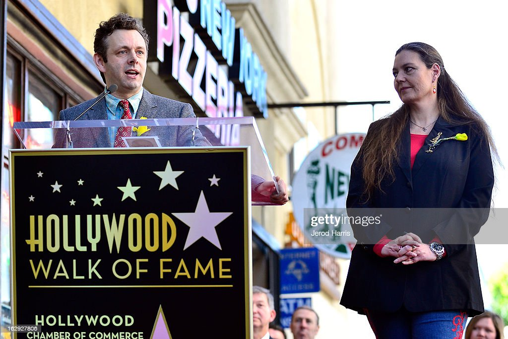 Actor <a gi-track='captionPersonalityLinkClicked' href=/galleries/search?phrase=Michael+Sheen&family=editorial&specificpeople=213120 ng-click='$event.stopPropagation()'>Michael Sheen</a> and <a gi-track='captionPersonalityLinkClicked' href=/galleries/search?phrase=Maria+Burton&family=editorial&specificpeople=1501381 ng-click='$event.stopPropagation()'>Maria Burton</a> (R) attend a ceremony honoring her father Richard Burton with a Star on the Hollywood Walk of Fame next to Elizabeth Taylor's star on March 1, 2013 in Hollywood, California.