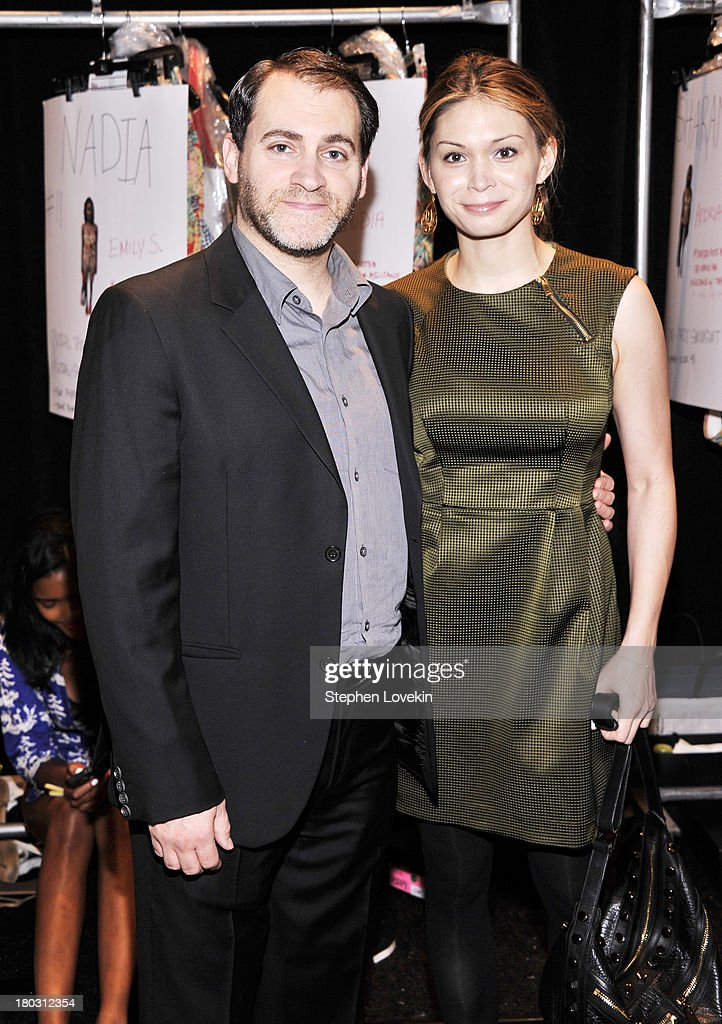 Actor Michael Stuhlbarg (L) and Mai-Linh Lofgren pose backstage at the Nanette Lepore fashion show during Mercedes-Benz Fashion Week Spring 2014 at The Stage at Lincoln Center on September 11, 2013 in New York City.