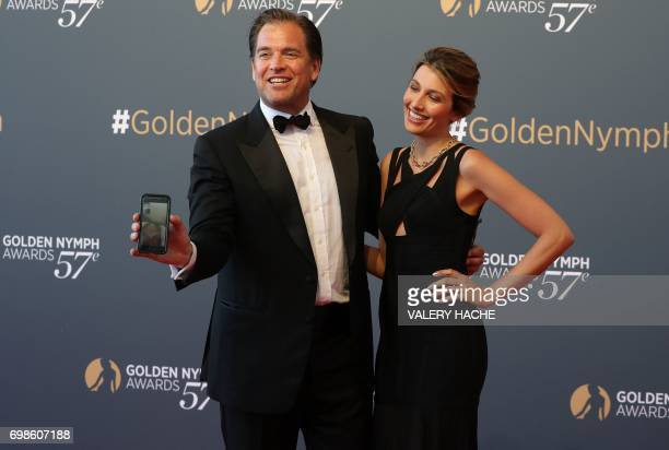 US actor Michael Weatherly poses with his wife Bojana Jankovic during the closing ceremony of the 57th MonteCarlo Television Festival on June 20 2017...