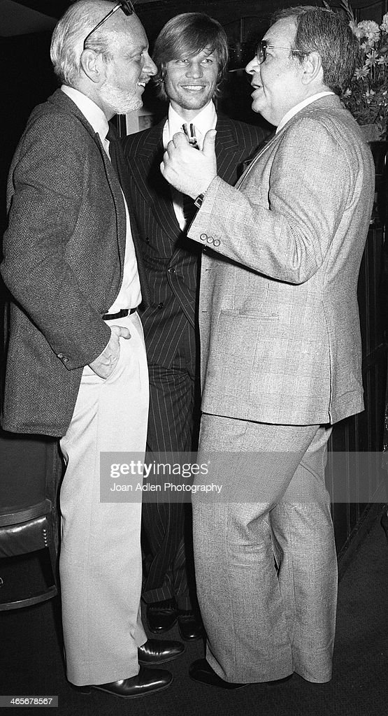 Actor Michael York chats with actor Tom Bosley and producer Hal Prince at the opening night dinner reception for 'Evita' at Chasen's Restaurant on...