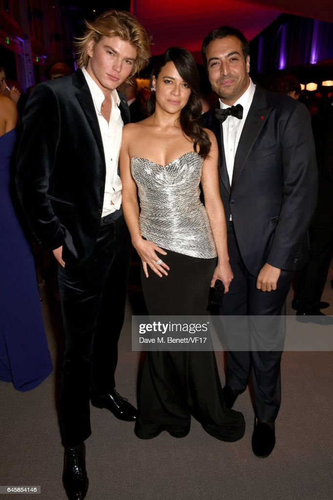 Actor Michelle Rodriguez (C), producer Mohammed Al Turki (R) and Australian model Jordan Barrett attend the 2017 Vanity Fair Oscar Party hosted by Graydon Carter at Wallis Annenberg Center for the Performing Arts on February 26, 2017 in Beverly Hills, California.