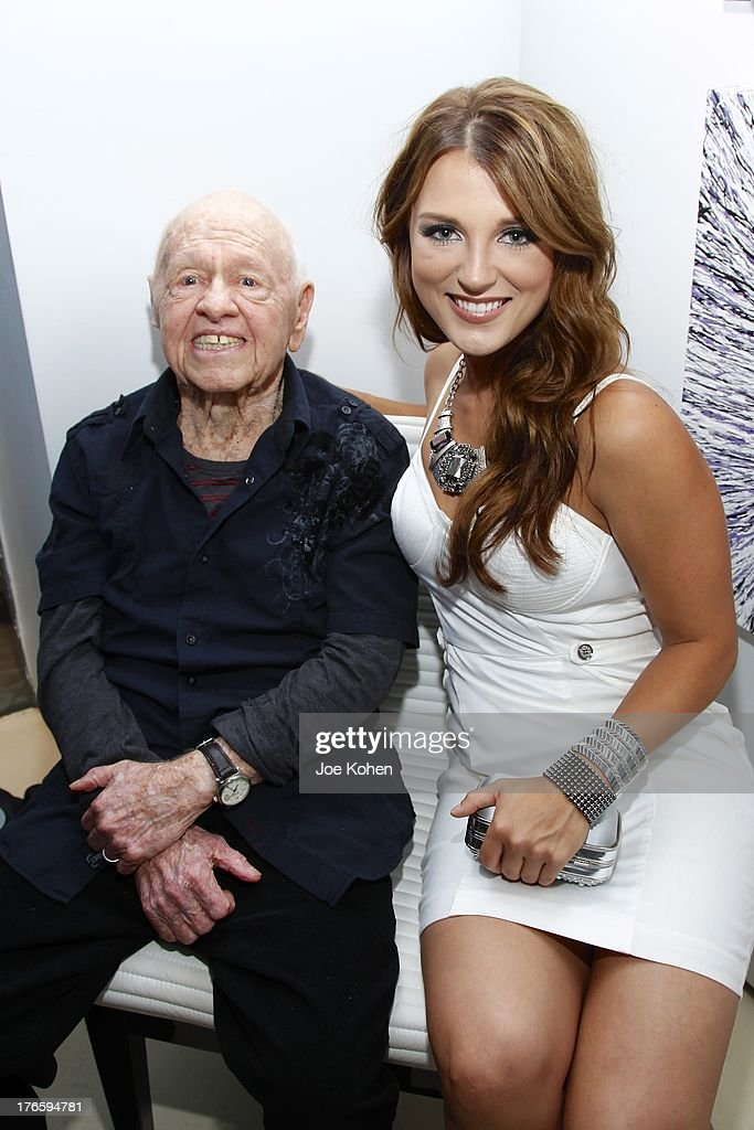 Actor Mickey Rooney and actress Katrina Norman attend Richard Grieco Hosts Opening Night Gala For His One-Man Art Exhibit 'Sanctum Of A Dreamer!' at Gallerie Sparta on August 15, 2013 in West Hollywood, California.