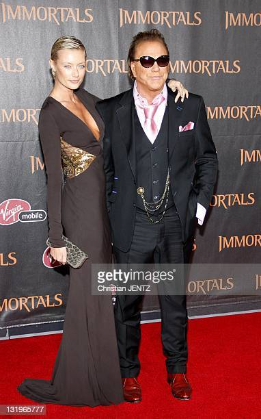 Actor Mickey Rourke and model Anastassija Makarenko arrive for the Premiere Of Relativity Media's 'Immortals' Presented In RealD 3D held at Nokia...