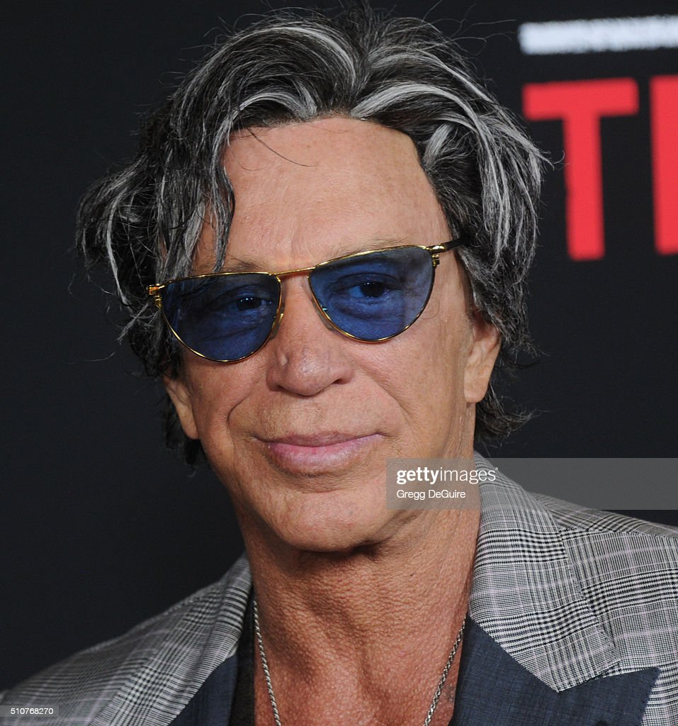 Actor Mickey Rourke arrives at the premiere of Open Road's 'Triple 9' at Regal Cinemas L.A. Live on February 16, 2016 in Los Angeles, California.