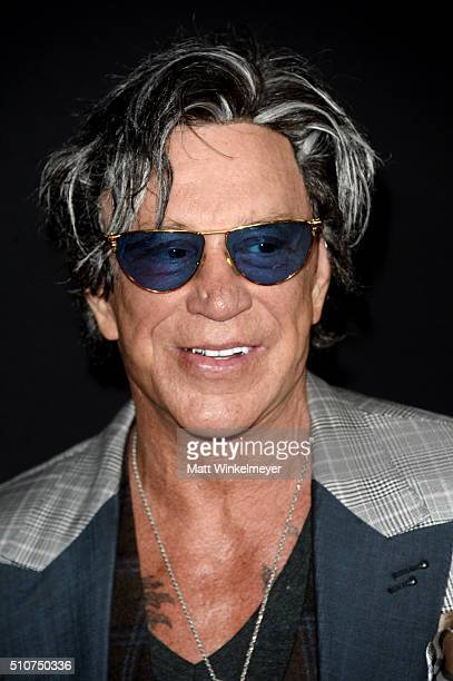 Actor Mickey Rourke attends the premiere of Open Road's 'Triple 9' at Regal Cinemas LA Live on February 16 2016 in Los Angeles California