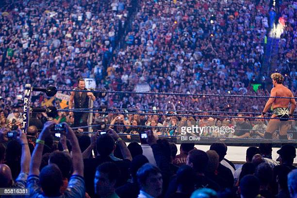 Actor Mickey Rourke steps into the ring while WWE Superstar Chris Jericho taunts him into a fight during WrestleMania 25 at Reliant Stadium on April...