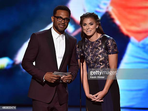 Actor Mike Epps and professional soccer player Alex Morgan speak onstage during The 2015 ESPYS at Microsoft Theater on July 15 2015 in Los Angeles...