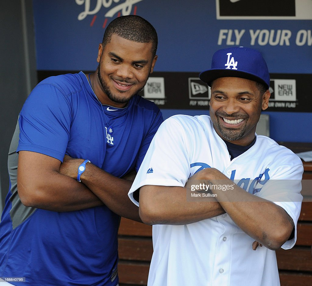 Actor <a gi-track='captionPersonalityLinkClicked' href=/galleries/search?phrase=Mike+Epps&family=editorial&specificpeople=2137559 ng-click='$event.stopPropagation()'>Mike Epps</a> (R) in the Dodger dugout with Dodger pitcher <a gi-track='captionPersonalityLinkClicked' href=/galleries/search?phrase=Kenley+Jansen&family=editorial&specificpeople=5751411 ng-click='$event.stopPropagation()'>Kenley Jansen</a> before the MLB game between the Los Angeles Dodgers and Washington Nationals at Dodger Stadium on May 15, 2013 in Los Angeles, California.