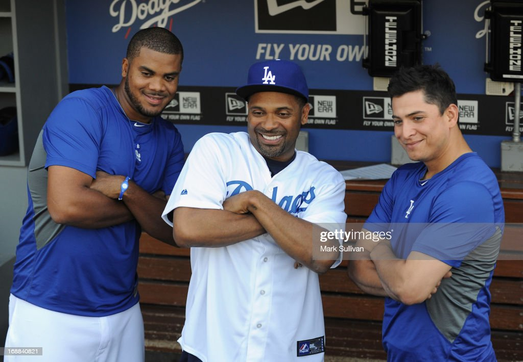 Actor <a gi-track='captionPersonalityLinkClicked' href=/galleries/search?phrase=Mike+Epps&family=editorial&specificpeople=2137559 ng-click='$event.stopPropagation()'>Mike Epps</a> in the Dodger dugout with Dodger pitchers <a gi-track='captionPersonalityLinkClicked' href=/galleries/search?phrase=Kenley+Jansen&family=editorial&specificpeople=5751411 ng-click='$event.stopPropagation()'>Kenley Jansen</a> (L) and <a gi-track='captionPersonalityLinkClicked' href=/galleries/search?phrase=Javy+Guerra+-+Baseball+Player&family=editorial&specificpeople=6779283 ng-click='$event.stopPropagation()'>Javy Guerra</a> (R) before the MLB game between the Los Angeles Dodgers and Washington Nationals at Dodger Stadium on May 15, 2013 in Los Angeles, California.