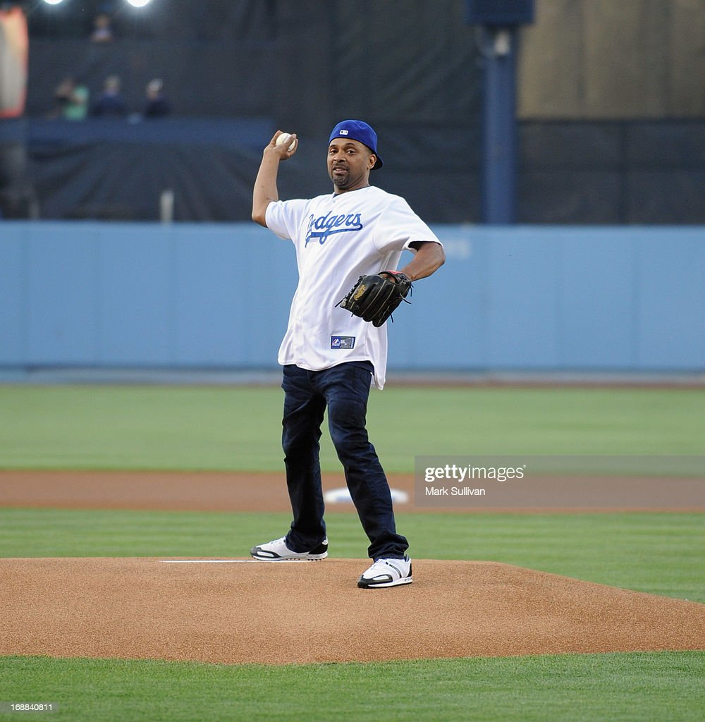 Actor <a gi-track='captionPersonalityLinkClicked' href=/galleries/search?phrase=Mike+Epps&family=editorial&specificpeople=2137559 ng-click='$event.stopPropagation()'>Mike Epps</a> throws out the ceremonial first pitch before the MLB game between the Los Angeles Dodgers and Washington Nationals at Dodger Stadium on May 15, 2013 in Los Angeles, California.