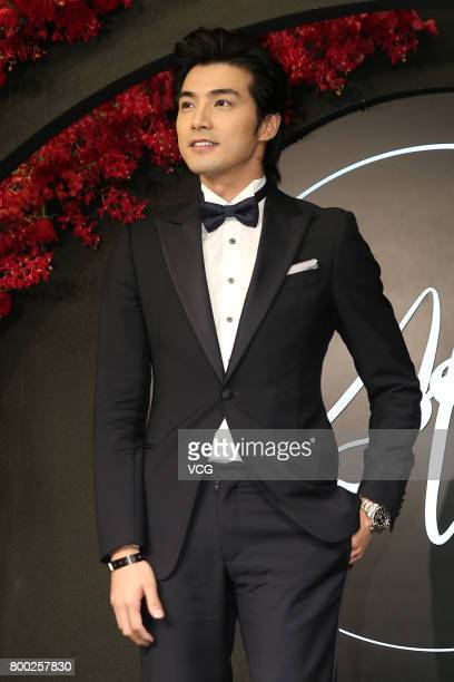 Actor Mike He arrives at the red carpet of the banquet held by Macau businessman Levo Chan and actress Ady An on June 23 2017 in Taipei Taiwan of...