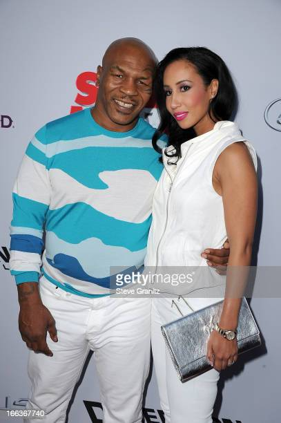 Actor Mike Tyson and Lakiha Spicer arrive at the 'Scary Movie V' Los Angeles premiere at ArcLight Cinemas Cinerama Dome on April 11 2013 in Hollywood...