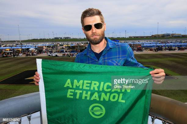 Actor Mike Vogel poses for a photo prior to waving the green flag for the Monster Energy NASCAR Cup Series Hollywood Casino 400 at Kansas Speedway on...