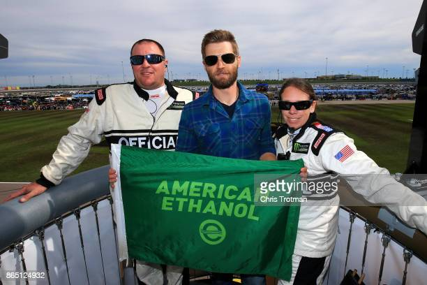 Actor Mike Vogel poses for a photo with the officials prior to waving the green flag for the start of the Monster Energy NASCAR Cup Series Hollywood...