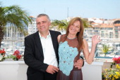 Actor Mikhail Barskovitch and actress Tatiana Chapovalova attend the 'Okhotnik' Photocall during the 64th Cannes Film Festival at the Palais des...