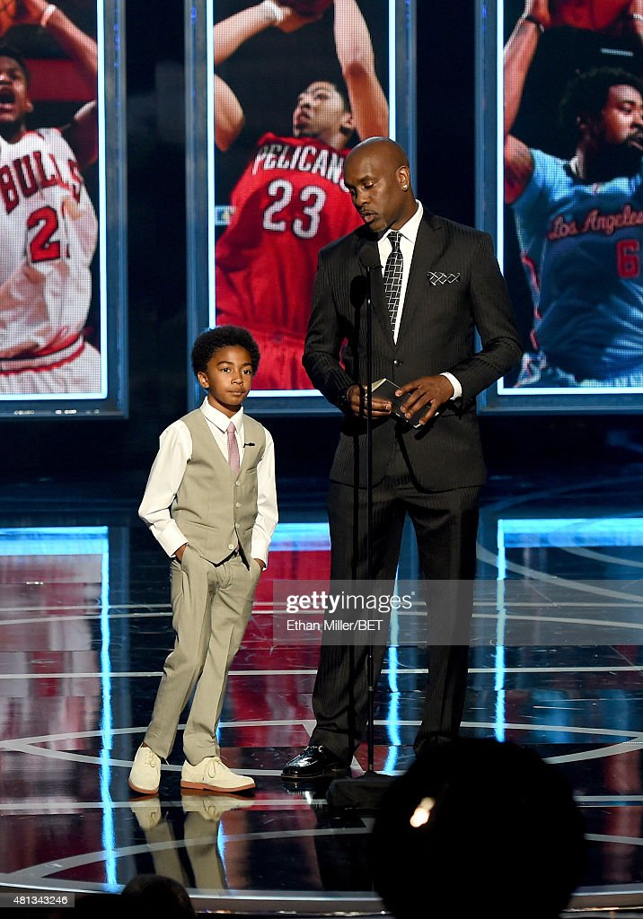 Actor <a gi-track='captionPersonalityLinkClicked' href=/galleries/search?phrase=Miles+Brown&family=editorial&specificpeople=6931307 ng-click='$event.stopPropagation()'>Miles Brown</a> (L) and former NBA player <a gi-track='captionPersonalityLinkClicked' href=/galleries/search?phrase=Gary+Payton&family=editorial&specificpeople=201500 ng-click='$event.stopPropagation()'>Gary Payton</a> present an award during The Players' Awards presented by BET at the Rio Hotel & Casino on July 19, 2015 in Las Vegas, Nevada.
