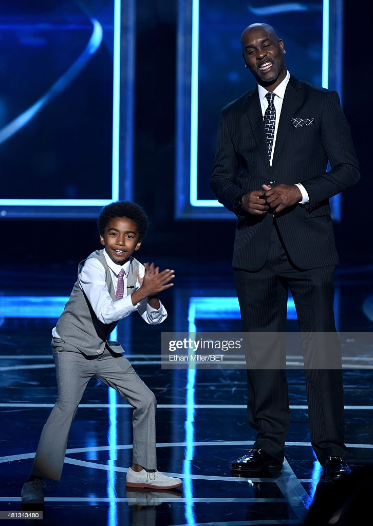 Actor Miles Brown (L) and former NBA player Gary Payton present an award during The Players' Awards presented by BET at the Rio Hotel & Casino on July 19, 2015 in Las Vegas, Nevada.