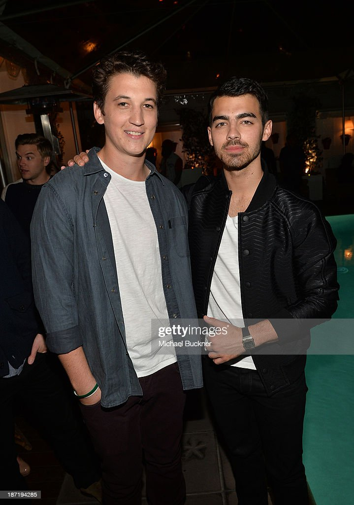 Actor <a gi-track='captionPersonalityLinkClicked' href=/galleries/search?phrase=Miles+Teller&family=editorial&specificpeople=6471673 ng-click='$event.stopPropagation()'>Miles Teller</a> (L) and actor/singer <a gi-track='captionPersonalityLinkClicked' href=/galleries/search?phrase=Joe+Jonas&family=editorial&specificpeople=842712 ng-click='$event.stopPropagation()'>Joe Jonas</a> attend Cotton Incorporated's Blue Jeans Go Green celebrates 1 million pieces of denim collected for recycling at SkyBar at the Mondrian Los Angeles on November 6, 2013 in West Hollywood, California.