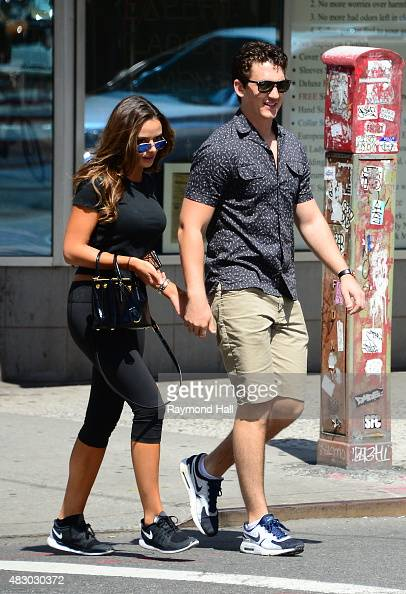 Actor Miles Teller and girlfriend Keleigh Sperry are seen in Washington Square Park watching a music band on August 5 2015 in New York City