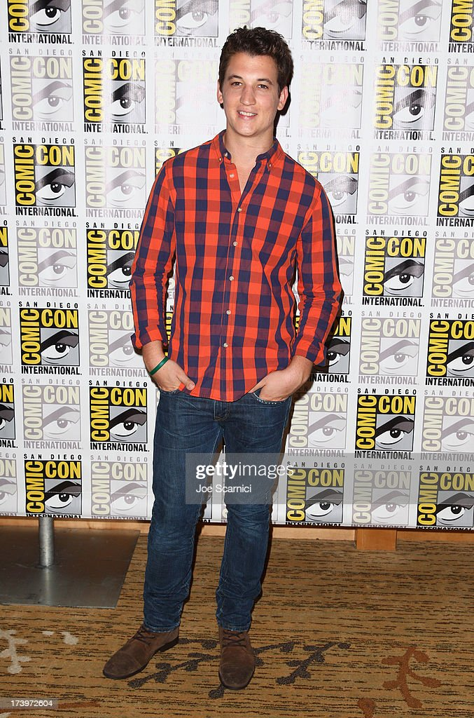 Actor <a gi-track='captionPersonalityLinkClicked' href=/galleries/search?phrase=Miles+Teller&family=editorial&specificpeople=6471673 ng-click='$event.stopPropagation()'>Miles Teller</a> attends 'Divergent' Comic-Con Press Line at San Diego Convention Center on July 18, 2013 in San Diego, California.