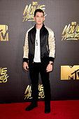 Actor Miles Teller attends the 2016 MTV Movie Awards at Warner Bros Studios on April 9 2016 in Burbank California MTV Movie Awards airs April 10 2016...