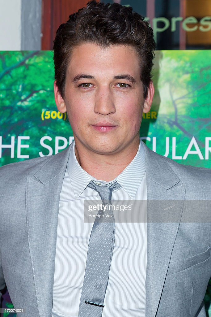 Actor <a gi-track='captionPersonalityLinkClicked' href=/galleries/search?phrase=Miles+Teller&family=editorial&specificpeople=6471673 ng-click='$event.stopPropagation()'>Miles Teller</a> wears Armani and arrives at 'The Spectacular Now' - Los Angeles Special Screening at the Vista Theatre on July 30, 2013 in Los Angeles, California.