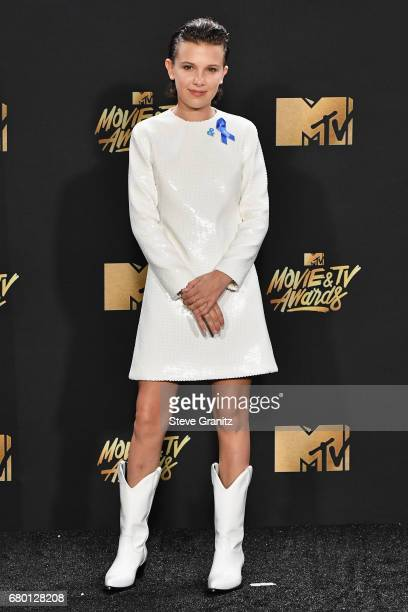 Actor Millie Bobby Brown poses in the press room at the 2017 MTV Movie and TV Awards at The Shrine Auditorium on May 7 2017 in Los Angeles California