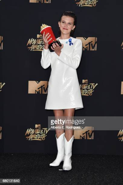 Actor Millie Bobby Brown winner of Best Actor in a Show for 'Stranger Things' poses in the press room during the 2017 MTV Movie And TV Awards at The...