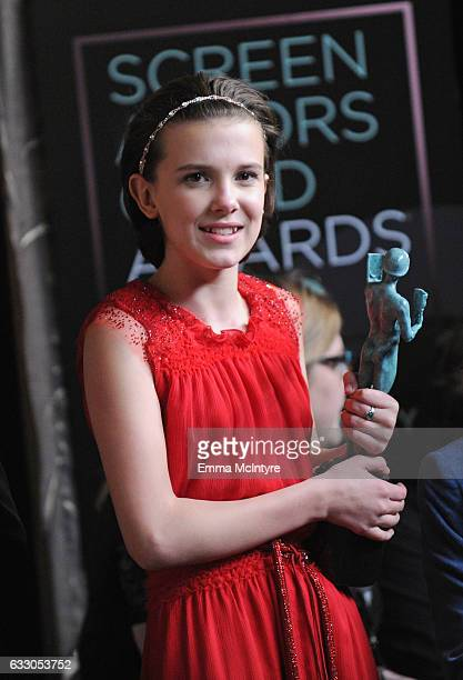 Actor Millie Bobby Brown winner of the Outstanding Ensemble in a Drama Series award for 'Stranger Things' poses during The 23rd Annual Screen Actors...