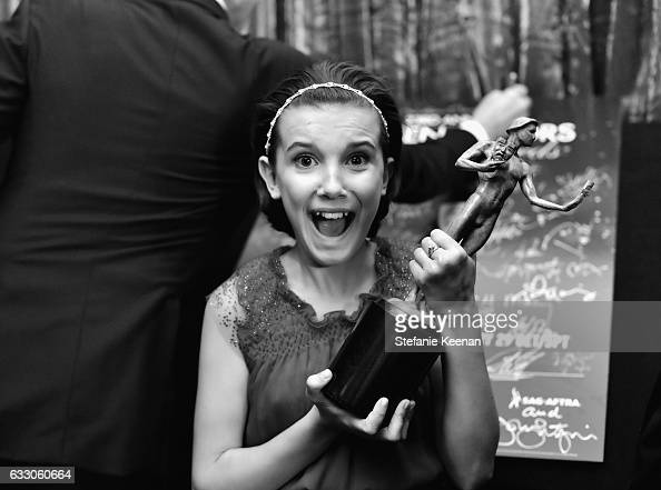 Actor Millie Bobby Brown winner of the Outstanding Ensemble in a Drama Series award for 'Stranger Things' poses in the press room during The 23rd...