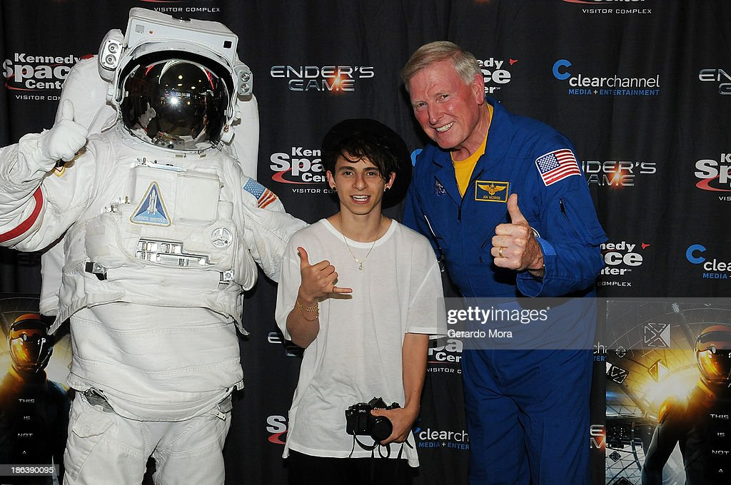Actor Moises Arias and astronaut Jon McBride pose during the 'Ender's Game' special screening hosted by Kennedy Space Center and Clear Channel at...